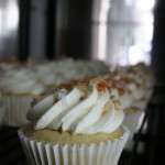 Vanilla Bean Cupcake filled with old fashion Coconut Custard and topped with toasted Coconut